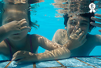 Girl and boy in swimming pool (Licence this image exclusively with Getty: http://www.gettyimages.com/detail/85071236 )
