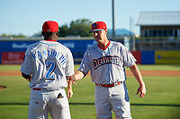 Clearwater Threshers manager Shawn Williams (11) shakes hands with Cornelius Randolph (2) during introductions before a game against the Dunedin Blue Jays on April 8, 2017 at Florida Auto Exchange Stadium in Dunedin, Florida.  Dunedin defeated Clearwater 12-6.  (Mike Janes/Four Seam Images)