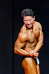 A bodybuilder competes in the Senior Men's Bodybuilding 70kg & below category during the 2016 Hong Kong Bodybuilding Championships on 12 June 2016 at Queen Elizabeth Stadium, Hong Kong, China. Photo by Lucas Schifres / Power Sport Images