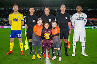 Michael Morrison of Birmingham City (left) Leroy Fer of Swansea City (right) with mascots during the Sky Bet Championship match between Swansea City and Birmingham City at the Liberty Stadium in Swansea, Wales, UK. Tuesday 29 January 2019