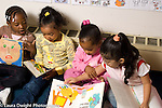preschool 3-4 year olds group of girls looking at picture books