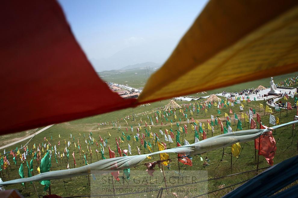 Tibetan payer flags line the hills on the Qinghai-Tibetan Plateau, Qinghai Province. China. 2010