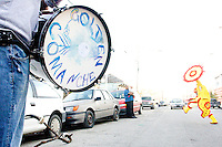 "A Golden Comanches Mardi Gras Indian ""spy boy"" halts traffic by dancing in front of a car in New Orleans on February 28, 2006."