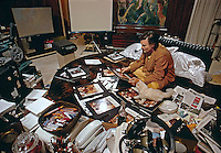 Hugh Hefner working in bed, Chicago, 1973. Color photo by John G. Zimmerman