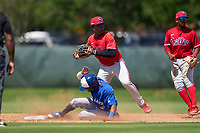 Philadelphia Phillies shortstop Jamari Baylor (3) looks to first base after forcing Hugo Cardona (26) out during an Extended Spring Training game against the Toronto Blue Jays on June 12, 2021 at the Carpenter Complex in Clearwater, Florida. (Mike Janes/Four Seam Images)