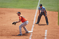 Bowie Baysox first baseman Adley Rutschman on defense as first base umpire Kelvis Velez looks on during the game against the Richmond Flying Squirrels at The Diamond on July 28, 2021, in Richmond Virginia. (Brian Westerholt/Four Seam Images)