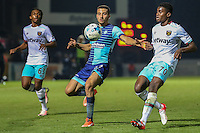 Nick Freeman of Wycombe Wanderers chases down the ball ahead of Vashon Neufville of West Ham United U21s (left) and Olatunji Akinola of West Ham United U21s (right) during the The Checkatrade Trophy match between Wycombe Wanderers and West Ham United U21 at Adams Park, High Wycombe, England on 4 October 2016. Photo by David Horn.