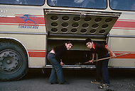 Children employed to upload luggage in the bus  in Istanbul, Turkey - Child labor as seen around the world between 1979 and 1980 - Photographer Jean Pierre Laffont, touched by the suffering of child workers, chronicled their plight in 12 countries over the course of one year.  Laffont was awarded The World Press Award and Madeline Ross Award among many ot hers for his work.