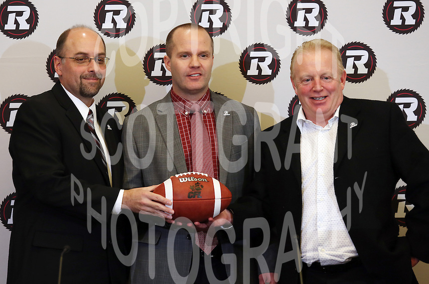 Marcel Desjardins GM Rick Campbell Head Coach Jeff Hunt President Ottawa RedBlacks 2013. Photo Scott Grant