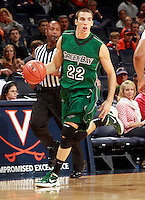 CHARLOTTESVILLE, VA- NOVEMBER 26:  Daniel Turner #22 of the Green Bay Phoenix handles the ball during the game on November 26, 2011 at the John Paul Jones Arena in Charlottesville, Virginia. Virginia defeated Green Bay 68-42. (Photo by Andrew Shurtleff/Getty Images) *** Local Caption *** Daniel Turner