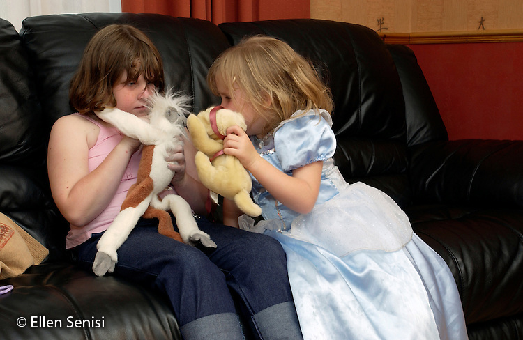 MR / Radley, Abingdon, Oxfordshire, England.Sisters (5, 9) play together with stuffed animals at home..MR: Web2, Web4.©Ellen B. Senisi