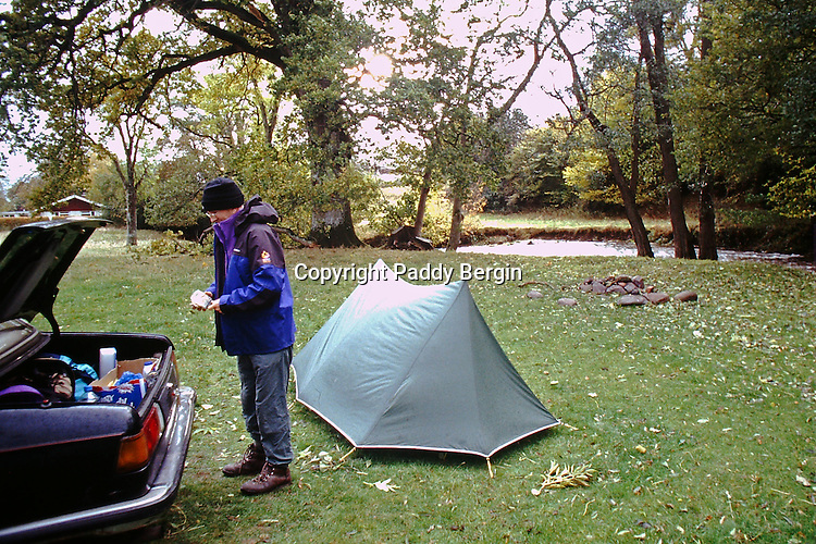 Camping,camping in Wales,camping by the river, Ardudwy area of Gwynedd, Wales,campsite,preparing for days walking.<br /> <br /> Stock Photo by Paddy Bergin