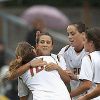 Boston College forward Stephanie McCaffrey (9) celebrates one of her three goals with teammates. Boston College (white) defeated Duke University (blue/white), 4-1, at Newton Campus Field, on October 6, 2013.