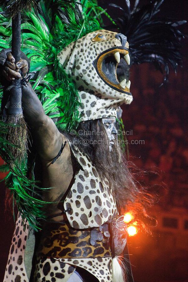 "Male Figure Representing Mayan Jaguar, a Warrior Figure.  Performance of ""Mexico Espectacular"", Xcaret, Playa del Carmen, Riviera Maya, Yucatan, Mexico."
