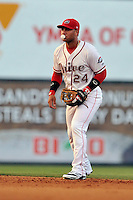 Second baseman Yoan Moncada (24) of the Greenville Drive blows a bubble playing infield in the fifth inning of a game against the Augusta GreenJackets on Thursday, July 16, 2015, at Fluor Field at the West End in Greenville, South Carolina. The Cuban-born 19-year-old Red Sox signee has been ranked the No. 1 international prospect in baseball by Baseball America. Greenville won, 11-5. (Tom Priddy/Four Seam Images)