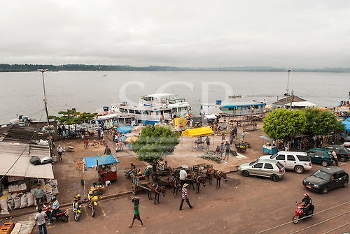 Amazon, Brazil. Port with boats vendors and horse and carts.