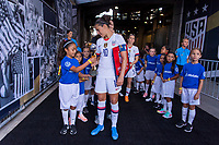 PASADENA, CA - AUGUST 4: A player escort is handed the World Cup Trophy by Carli Lloyd #10 during a game between Ireland and USWNT at Rose Bowl on August 3, 2019 in Pasadena, California.