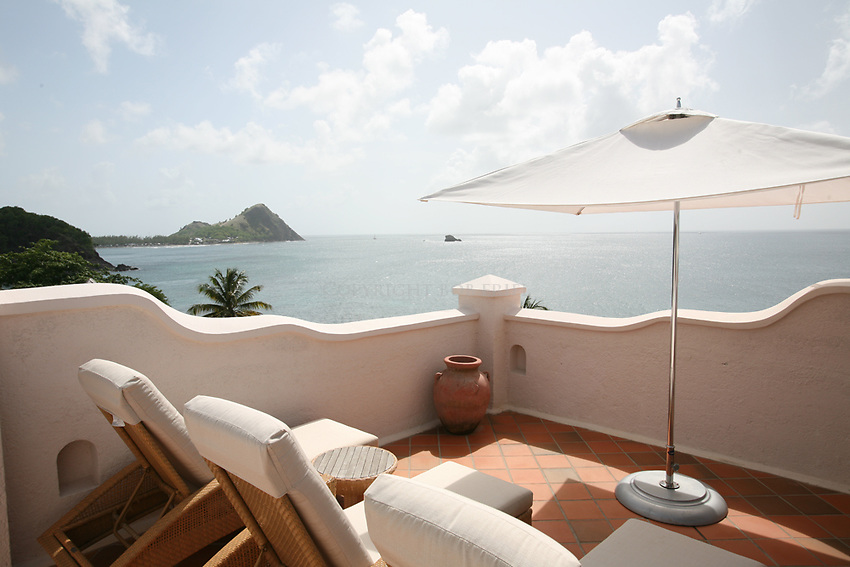 """Rootop plunge pool at Cap Maison """"villa"""" suite. Pigeon Island in background."""