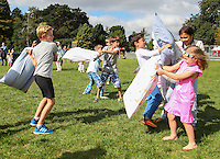 2016 09 18<br /> Pictured: Picnic goers have a pillow fight. The Great Pyjama Picnic, Bute Park, Cardiff.Sunday 18 September 2016<br /> Re: Roald Dahl's City of the Unexpected has transformed Cardiff City Centre into a landmark celebration of Wales' foremost storyteller, Roald Dahl, in the year which celebrates his centenary.