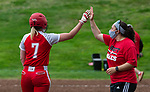 WOLCOTT, CT 051021JS15—Wolcott's Katie Cosmos (7) gets a high-five from head coach Gabby Gallucci after ripping a two-RBI triple  during their NVL softball game with Torrington Monday at Wolcott High School. Jim Shannon Republican American