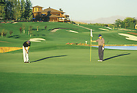Golfer putting on green.  Apple Tree Golf Resort, Yakima, WA.  MR/PR