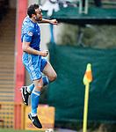 Andrew Considine celebrates his goal for Aberdeen