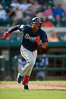 Atlanta Braves center fielder Cristian Pache (77) runs to first base during a Grapefruit League Spring Training game against the Detroit Tigers on March 2, 2019 at Publix Field at Joker Marchant Stadium in Lakeland, Florida.  Tigers defeated the Braves 7-4.  (Mike Janes/Four Seam Images)