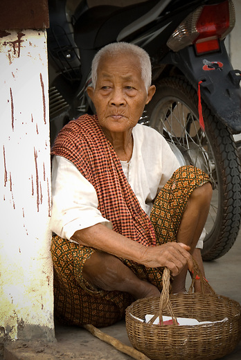 Elderly man in a small village around 30 km from Siem Reap takes a break from his work. Life in the small villages is at a much slower pace as compared to life in the city of Siem Reap despite it's proximity.