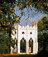 The Gothic Temple, a rebuilt ruin,  is at the end of an avenue of pines and hedges at Painshill Park, Surrey, England, 1738. Owned and designed by Hon. Charles Hamilton.