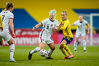 SOLNA, SWEDEN - APRIL 10: Julie Ertz #8 of the United States heads battles for a ball blindly during a game between Sweden and USWNT at Friends Arena on April 10, 2021 in Solna, Sweden.