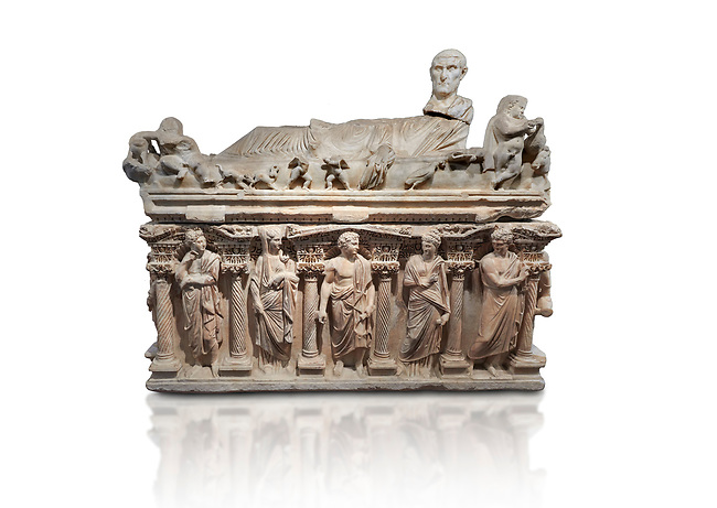 """Roman relief sculpted sarcophagus with kline couch lid with a reclining male figuer depicted, """"Columned Sarcophagi of Asia Minor"""" style typical of Sidamara, 3rd Century AD, Konya Archaeological Museum, Turkey. Against a white background."""