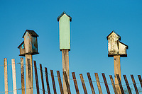 Three birdhouses.