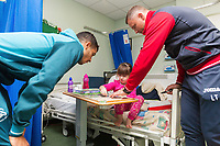 Thursday 21 December 2017<br /> Pictured: Kyle Naughton of Swansea City and Lee Trundle<br /> Re: Swansea City Childrens Ward Visit, Morriston Hospital, Swansea, Wales, UK
