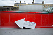 Sign pointing to marketing suite on the Kings Cross development site, London.  About 40% of the newly re-developed 67-acre site is deemed public space, although the entire site is privately owned and managed.