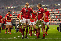 Pictured: Alun Wyn Jones and Jonathan Davies of Wales celebrate winning the Grand Slam during the Guinness six nations match between Wales and Ireland at the Principality Stadium, Cardiff, Wales, UK.<br /> Saturday 16 March 2019