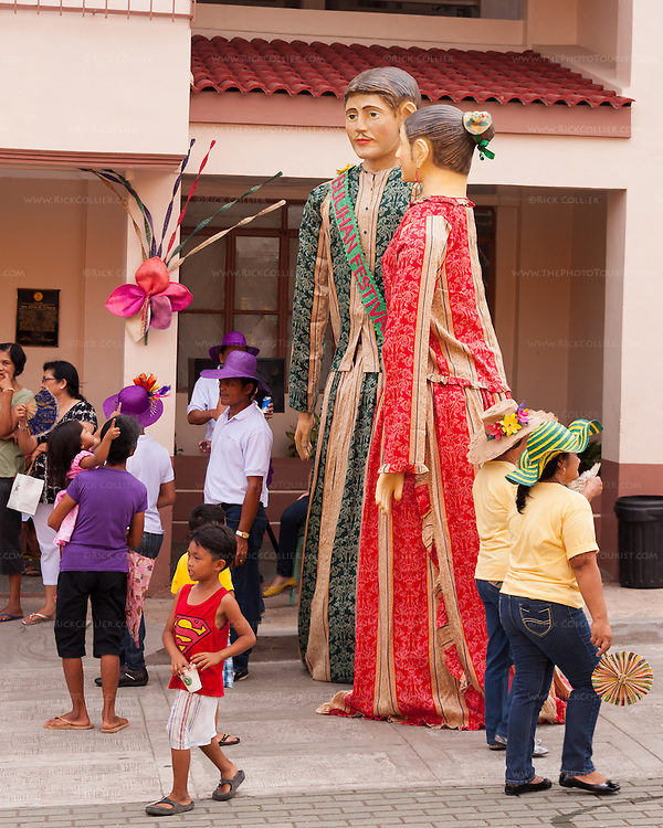"""Oversized puppet figures, the Bulihan """"king"""" and """"queen,"""" led the parade that opened the Sampaloc Bulihan Festival in April 2012. (Sampaloc, Quezon Province, the Philippines.)"""