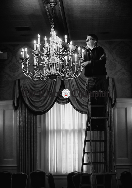 Let There Be Light...Maintenance man Austin Russell replacing bulbs in a chandelier in the function room of the Old Ground Hotel in Ennis. Photograph by John Kelly.