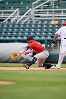 New Hampshire Fisher Cats first baseman Juan Kelly (25) stretches to receive a throw during the first game of a doubleheader against the Harrisburg Senators on May 13, 2018 at FNB Field in Harrisburg, Pennsylvania.  New Hampshire defeated Harrisburg 6-1.  (Mike Janes/Four Seam Images)