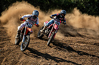 Oliver Beamish scraps with Junior Thomas during the Richard Fitch Memorial Trophy Motocross at Wakes Colne MX Circuit on 18th July 2021