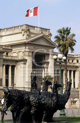 Lima, Peru. Palacio de Justico - Palace of Justice, with statue of llamas and the Peruvian flag.