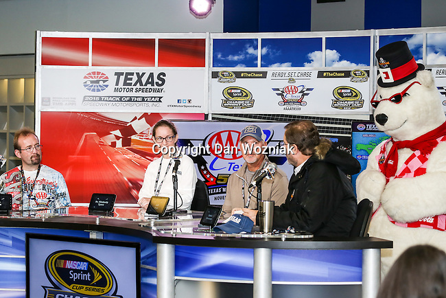 Anartica scientists and occupants conduct an interview before the NASCAR AAA Texas 500 race at Texas Motor Speedway in Fort Worth,Texas.