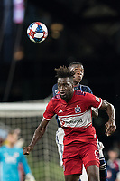 FOXBOROUGH, MA - AUGUST 25: C.J. Sapong #9 of Chicago Fire battles for head ball during a game between Chicago Fire and New England Revolution at Gillette Stadium on August 24, 2019 in Foxborough, Massachusetts.