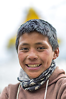 Portrait of Subash Tamang, 11 years old, (finished class 8). <br /> Weight: 30-40 kilo. (Doesn't know exactly.)<br /> Carrying: 15 kg of stone for the new path with prayer wheels in Namche.)<br /> Likes playing fotball.