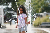 Melina Singleterry, 8, of Rogers plays, Sunday, September 12, 2021 at the Lawrence Plaza splash pad in Bentonville.  Sunday was the last day to enjoy the Fountains at Lawrence Plaza. Look for details soon about the Rink at Lawrence Plaza, which is scheduled to open on Saturday, Nov. 20, according to the city's Facebook page. Check out nwaonline.com/210913Daily/ for today's photo gallery. <br /> (NWA Democrat-Gazette/Charlie Kaijo)