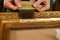 BNPS.co.uk (01202 558833)<br /> Pic: ZacharyCulpin/BNPS<br /> <br /> Guilding a frame<br /> <br /> Antique frames are being carefully restored using centuries-old techniques at a small central London business.<br /> <br /> Rollo Whately Ltd, off St James's Street, was started by Rollo 22 years ago and have a range of fine art auction and museum clients.<br /> <br /> He is assisted by wood carver Borys Burrough in restoring frames, typically dating from the 17th to the 19th century.