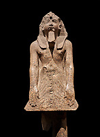 Ancient Egyptian statue of Ramesses II , granite, New Kingdom, 18th Dynasty, (1500-1400 BC, Karnak, Temple of Mut. Egyptian Museum, Turin. black background.<br /> <br /> The statue depicting Ramesses II  was reworked over a statue of an earlier pharaoh. This can be seen around the corners of the mouth which show reworking. The roundness of the face and short apron also point to an earlier style.  Ramesses II is depicted praying with his arms out straight and his hands resting flat on the apron of his kilt.