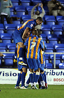 Pictured: Nicky Wroe of Shrewsbury celebrating his goal mobbed by team mates. Tuesday 23 August 2011<br /> Re: Carling Cup Shrewsbury Town FC v Swansea City FC at the Greenhous Meadow ground, Shropshire.