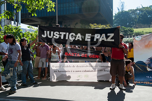 """Indigenous people with a banner, """"Justice and Peace"""", protest outside BNDES, the Brazilian Development Bank, after marching from the People's Summit at the United Nations Conference on Sustainable Development (Rio+20), Rio de Janeiro, Brazil, 18th June 2012. Photo © Sue Cunningham."""