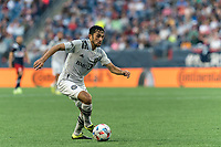 FOXBOROUGH, MA - JULY 25: Mathieu Choiniere #29 of CF Montreal dribbles during a game between CF Montreal and New England Revolution at Gillette Stadium on July 25, 2021 in Foxborough, Massachusetts.