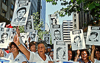 Relatives of 'disappeared' political prisoners hold up placards with the missing people's picture beneath the words Donde Estan?' (where is?) during a rally calling for a 'No' vote in the 1988 referendum. This asked the people to choose either 'Yes', for a continuation of Pinochet's rule or 'No', for him to leave office.